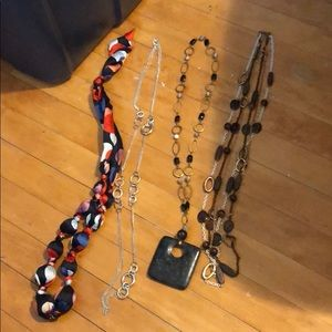 Lot of long necklaces.